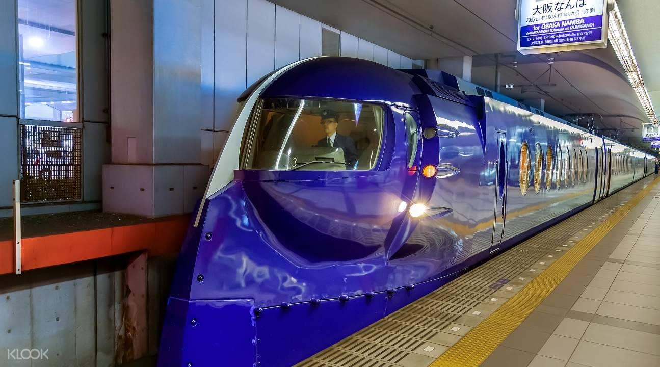 Nankai Limited Express train in a station; the train is purple